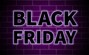 Black Friday black inscription on brick wall background